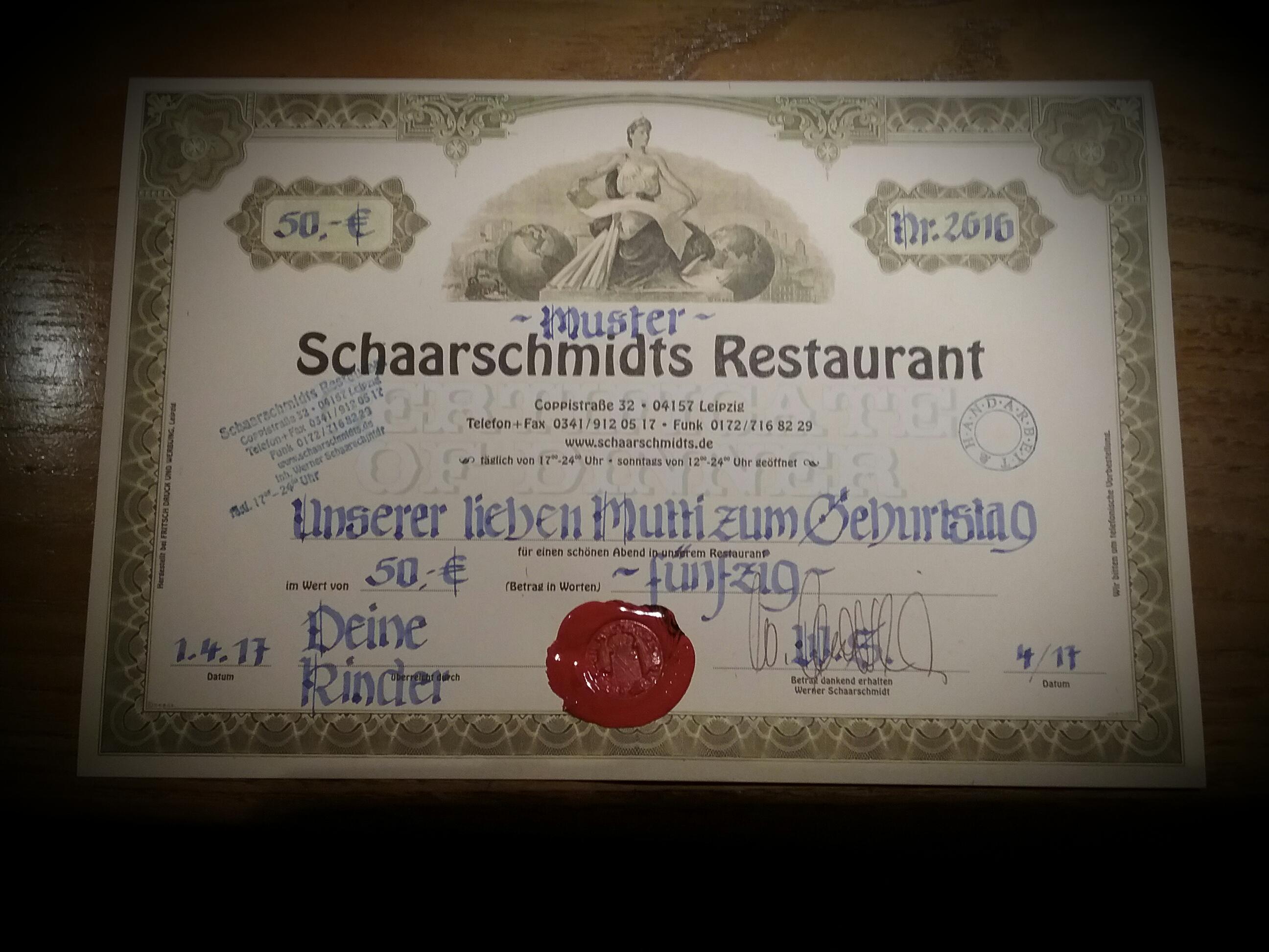 Unser Restaurantgutschein bestehend aus einer alten Aktie des Waldorf Astoria New York ist stilvoll kaligraphisch beschriftet und mit altem Siegel